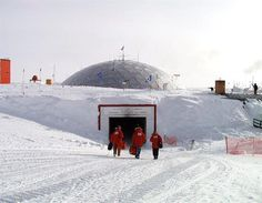 Members of the U.S. Antarctic Program walk toward the Amundsen-Scott South Pole Station dome entrance.