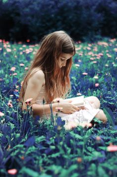 A girl reading amongst the flowers.