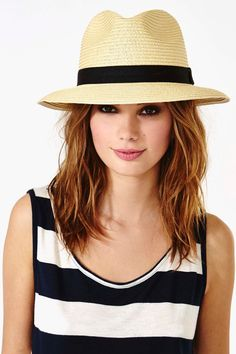 I greatly like Panama Hats. The carry a definite bohemian air, I think. Also, this female is lovely.