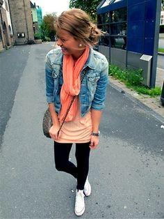 Denim jacket, orange shirt and scarf, and black pants