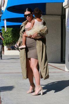 Kim Kardashian Photos Photos - Reality stars Kim Kardashian and her sister Kourtney take their daughters North