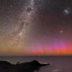 The Southern Lights or Aurora Australis is photographed above the southern coast of Australia near Melbourne. The Milky Way is visible over the southeast in the constellations Scorpius (at the horizon), Ara, Norma, Centaurus, and Crux (the Southern Cross, at top). Photo by: Alex Cherney/Terrastro.com