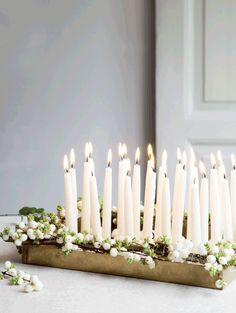 Scandinavian Christmas Decorations | a gold tray of white candles decorated with snow berries