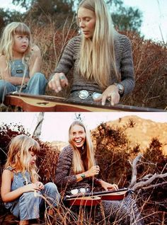 Joni Mitchell playing the dulcimer to a young fan in her house in Laurel Canyon, 1970