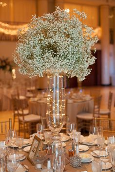 Voluminous baby's breathe and fairy lights add a magical touch for Jesse and James at DuPont Country Club. Amy Tucker Photography.