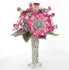 "NO to the color and bouquest...YES to the glitzy handle that doubles as a ""vase""or stand!"