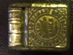 Antique match safe.
