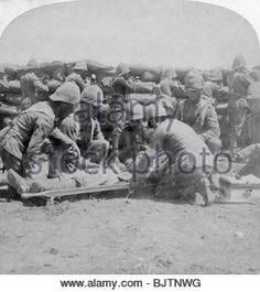 First aid to a wounded fusilier, Honey Nest Kloof Battle, Boer War, South Africa, February Stereoscopic card. British Colonial, British Army, First Aid, Nest, Battle, Military, War, South Africa, February