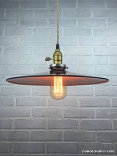 This simple industrial pendant lamp is elegant and full of vintage charm.  It starts with