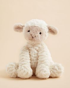 This extra soft lamb from Jellycat is perfect for decorating an animal-themed nursery or for cuddling at playtime. | Polyester fiber/plastic pellets | Surface clean | Imported | Suitable from birth |