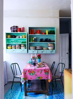 ohhh paint an old bookshelf and mount to the wall ...awesome idea! Must do.