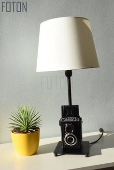 Handcrafted table lamp made from an old (used) Lubitel camera.  Comes with a 150 cm long cord. The lampshade and the bulb is not included (IKEA).  Size with shade: 13x13x50 Size without shade: 13x13x36  Bulb: E14, max 40w, 220V  Can be installed with UK or EU plug. If you can not find your