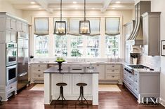 Contemporary White Kitchen with French Windows | LuxeSource | Luxe Magazine - The Luxury Home Redefined