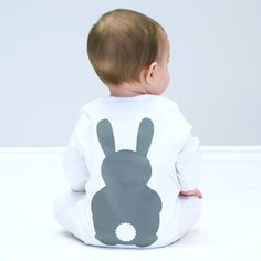 Our gorgeously soft bunny sleep suits feature our cute rabbit, Bramble! They make a great gift for your new baby, nephew, niece, godson, god daughter or grandchild for their birthday, Christmas, a baby shower, Easter, Christening or birth! They are perfect for lovers of woodland animals. The baby grows are long sleeved with feet and have an envelope neck line and popper fastening around the legs. They are made of 100% cotton. The sleep suit is white with a grey bunny. copyright…
