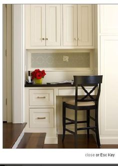 Kitchen desk with fabric cork board. I could easily do this look. It would requiring some throwing junk out though.