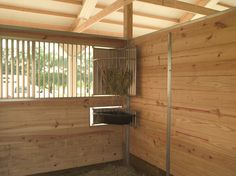 swing-out hay/grain feeder
