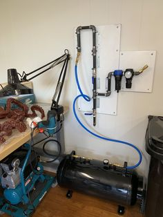 Use of a small hotdog compressor with 20 gal. Newly installed water trap with regulator. Ceiling mounted, air hose with reel next! Garage Tools, Garage Shop, Diy Garage, Garage Workshop, Air Compressor Repair, Air Compressor Tank, Woodworking Shop, Woodworking Plans, Using A Paint Sprayer