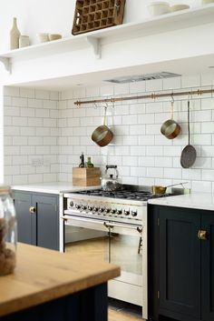 In place of cupboards, use hooks and rods to store regularly used items and keep everything else packed away. | Designer: deVOL Kitchens