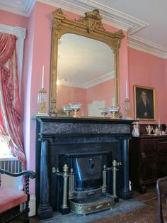 pink walls, gilt mirror, black marble fireplace, victorian home Victorian Life, Victorian Cottage, Victorian Decor, Victorian Homes, Victorian Interiors, Crawford House, Fancy Mirrors, Bright Paint Colors, Orange Rooms