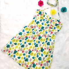 American Eagle Outfitters Floral Sundress Great vintage silhouette, very flattering bust line with elastic smocking in the back for a perfect fit. Skinny ties can be done several ways! No flaws, shown on a 6-8 dress form, runs true to size. American Eagle Outfitters Dresses