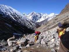 Climbing expedition porters carry loads in doko baskets over the high passes from Gokyo to Mt. Everest.