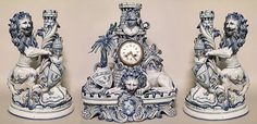 French Victorian blue and white porcelain lion clock and pair of candelabra (sgn