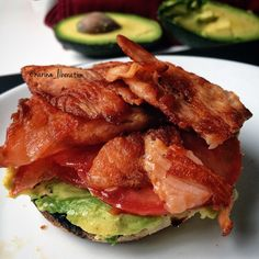 Crispy Smoked Salmon, Garlic Avocado and Tomato on a toasted English Muffin