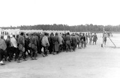 Soviet prisoners of war at the entrance to the prisoner of war camp established by the Germans in Biala Poldaska, Poland. Polish Government, Prisoners Of War, World War Ii, Wwii, Poland, Entrance, The Past, Death, Europe