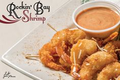 Rockin' Bay Shrimp - 8 fried shrimp skewered and dusted with LEDO Chesapeake seasoning. Served with a side of Chipotle Ranch. Garnished with Pepperoncinis & Lemon. 6.99
