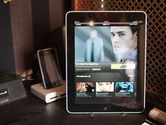 DIY - A basic metal bookend along with six rubber feet are all you need to keep your tablet in a full upright position.