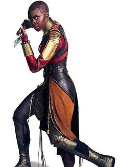 """The fictional Dora Milaje — """"adored ones,"""" an all-female military group that protects the King and the fictional nation of Wakanda. The Dora Milaje were introduced in Black Panther comic by Christopher Priest, who took over as lead writer of the series in"""