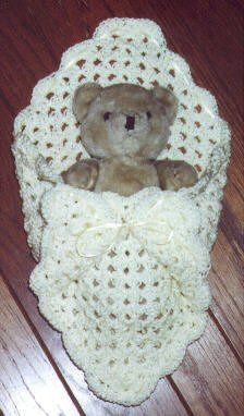 Pouch for doll or stuffed animal - free crochet pattern. I can't help thinking that a little bigger and you have a pouch for a newborn.