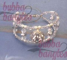 Clear Czech Beads with Clear and Silver Swarovski Crystals and a Metal Focal with Clear Rhinestones by Bubba Bangles