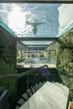"""archatlas: """" The Wall House by Guedes Cruz Arquitectos Like a wall in a Castle not in stone, but in concrete, glass and wood.Not to for protection but because of the neighbours and the strong Atlantic Wind.A Patio house with a Mediterranean country. Villa Luxury, Glass Bottom Pool, Glass Pool, Design Exterior, Dream Pools, Best Interior Design, Modern House Design, Villa Design, Loft Design"""