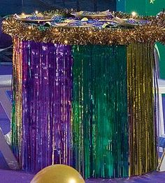 Use our Mardi Gras metallic table skirt to dress up your party tables with purple, green and gold.