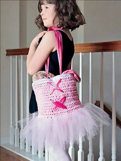 Super adorable, this fun bag is perfect for your little ballerina. The bag is creatively crocheted from tulle rather than yarn, adding a distinctive look. The large size of the soft tulle makes this project both easy and quick.