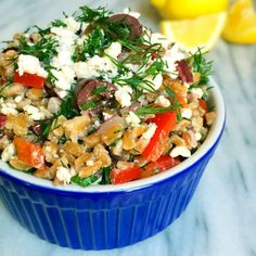 Chewy farro is tossed together with classic Greek flavors like fresh dill, kalamata olives and feta cheese to create this healthy and delicious whole grain salad.