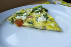 Easy Veggie Fritatta  serves 2-4  total time: 20 minutes  total hands on time: 12 minutes    What you'll need:  about a tbsp olive oil, butter or margarine  about 10 asparagus spears, chopped  1 small tomato, chopped or diced  2 handfuls torn baby spinach  7 eggs (I used 4 whole eggs and 3 egg whites)  splash of milk  fresh pepper  1 small handful feta cheese