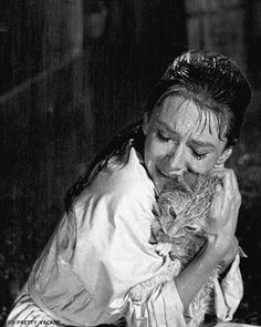 Holly Golightly (Audrey Hepburn) and Cat. Breakfast at Tiffany's.