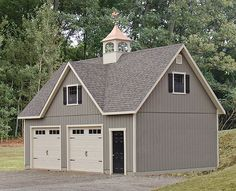 GAF Timberline HD shingles in weathered wood with gray siding and black details.