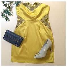 Yellow Strapless Mini Dress w/Blue Embroidery Be the belle of the ball in this gorgeous embroidered mini! Features a sweetheart neckline, two hidden pockets at waist, built-in slip lining, and side zipper closure. Length is 27 inches from top of sweetheart neckline to bottom of hem and 24 inches when measured from armpit to hem. Waist is 14 inches laying flat. Bust (armpit to armpit while laid flat) is 16 inches. Material is 55% cotton, 40% polyester, and 5% spandex w/ 100% rayon lining…