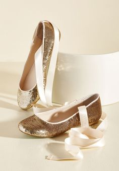Center Stage Sensational Flat | Mod Retro Vintage Flats | ModCloth.com  A glittering update to the traditional ballet flat? Yes 'plies'! Betsey Johnson delivers yet another stunning style in the form of these show-stopping skimmers, complete with gold-sequined uppers and champagne-hued, satin ankle ribbons. These kicks won't be without an encore!
