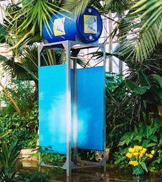 simple outdoor shower design--black barrel or shower bag for solar heated water