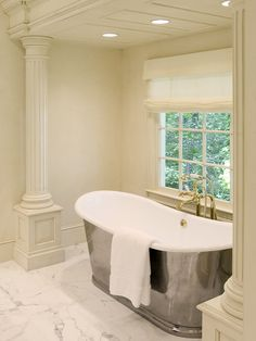 I love the idea of putting a tub (like this one) or a claw foot tub under a window.