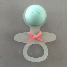 Darling Baby Shower Party Favor: Yep, that's an Eos lip balm in the center of the baby rattle. How clever is that?!