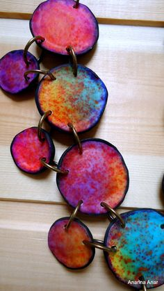 Polymer clay necklace. Looks like Alcohol Inks may have been used here? Yummy.