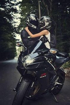GSXR love- a couple embraces, staring at each other through their visors. They clearly know that the view is always better from inside a hel...
