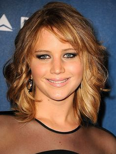 Jennifer Lawrence's beachy bob is also red-carpet ready. She opts for sunny ombré highlights and controlled texture that shines with a glossy finish. Use a dry shampoo on ends first, twisting strands into loose ringlets, and finish the style with a misting of satin hair spray. via @stylelist