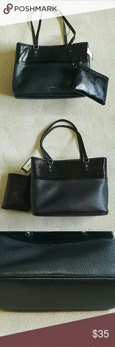 """NWT! Nine West Tote & Wristlet Set Add street chic flavor to your purse collection with this  black faux leather tote and wristlet set from Nine West. Tote features an upper glossy reptile inspired panel with a faux pebbled leather bottom panel. Double flat top handles with 10in. drop. Magnetic snap top closure with Nickel tone hardware. One zip and two slip pockets inside. Top zip closure matching reptile embossed wristlet with detachable wrist strap.  Dimensions 14"""" x 5"""" x 10"""" Nine West…"""
