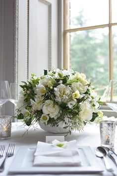 Combine peonies, helleborus, jasmine, ranunculus and foliage for a classic and chic floral tablecentre.